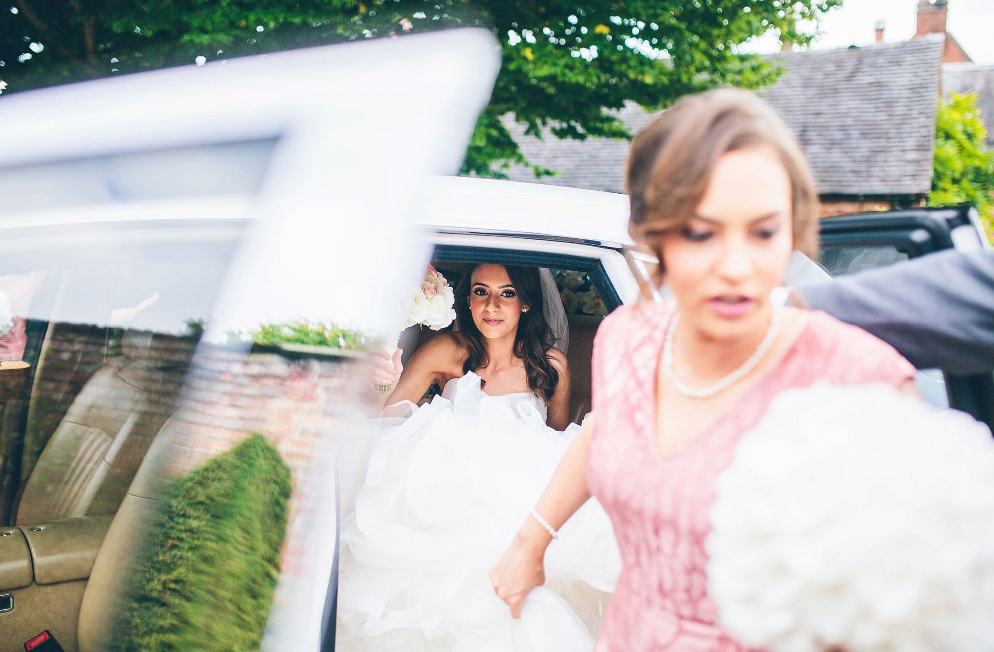 Bride and bridesmaid arriving at Combermere Abbey for the wedding