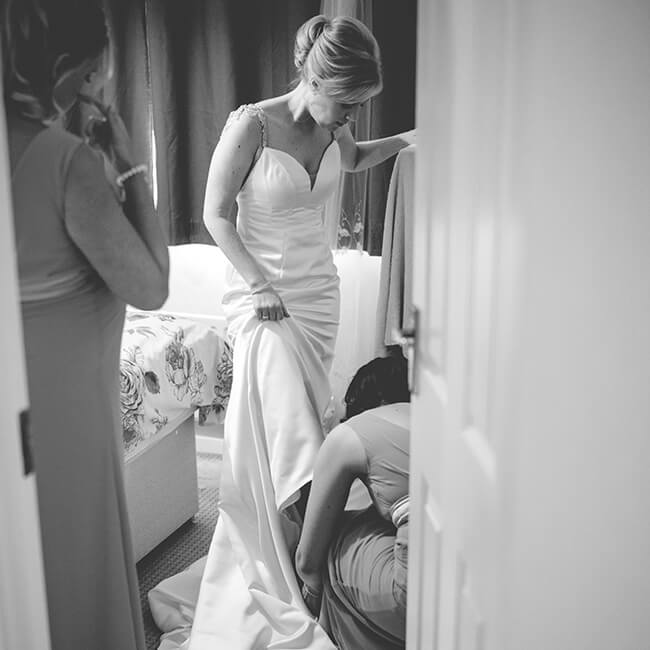 The beautiful bride gets ready in the wedding accommodation at Combermere Abbey