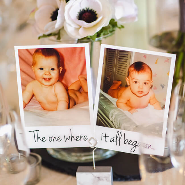 Scott and Kate decorated the venue with childhood photos including the photos for the table names – wedding ideas