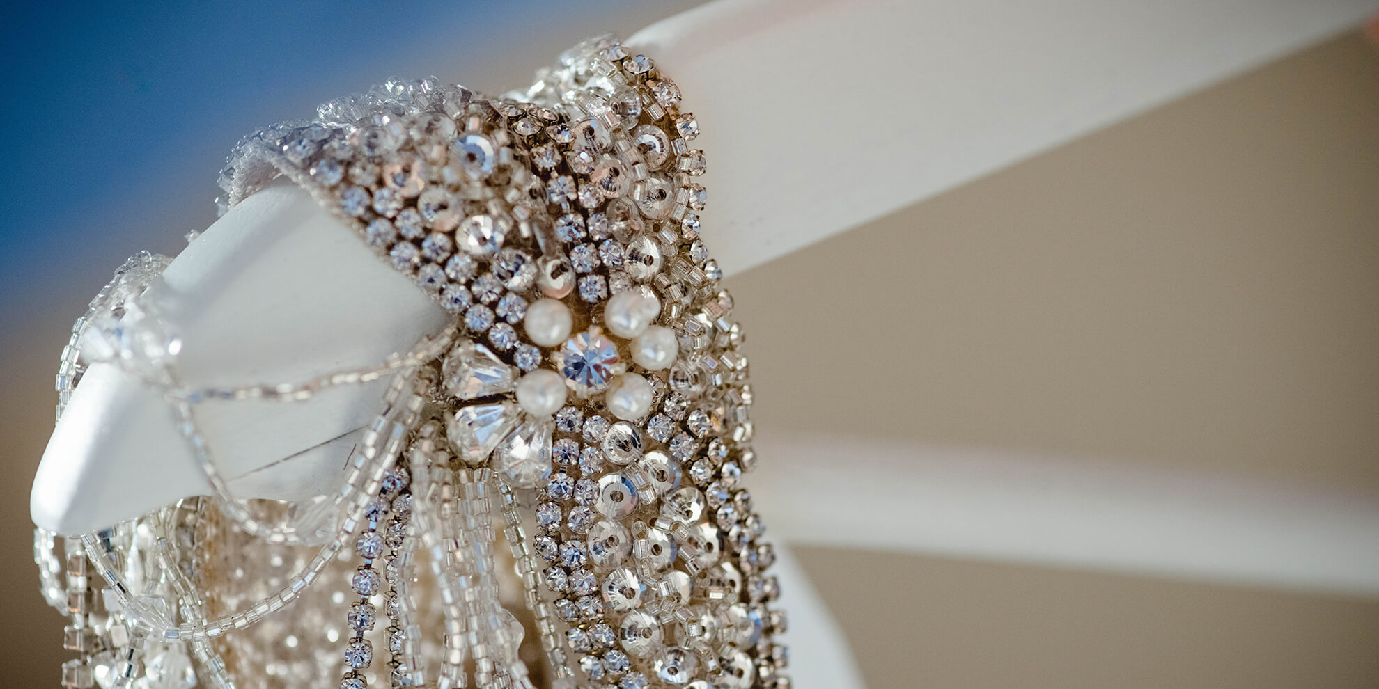 A close up of the bride's wedding dress which had embroidered sparkly straps – wedding dress ideas