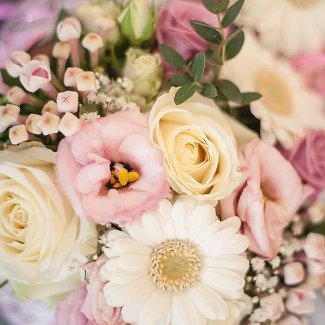 A close look at the bride's wedding flowers – pink and white flowers
