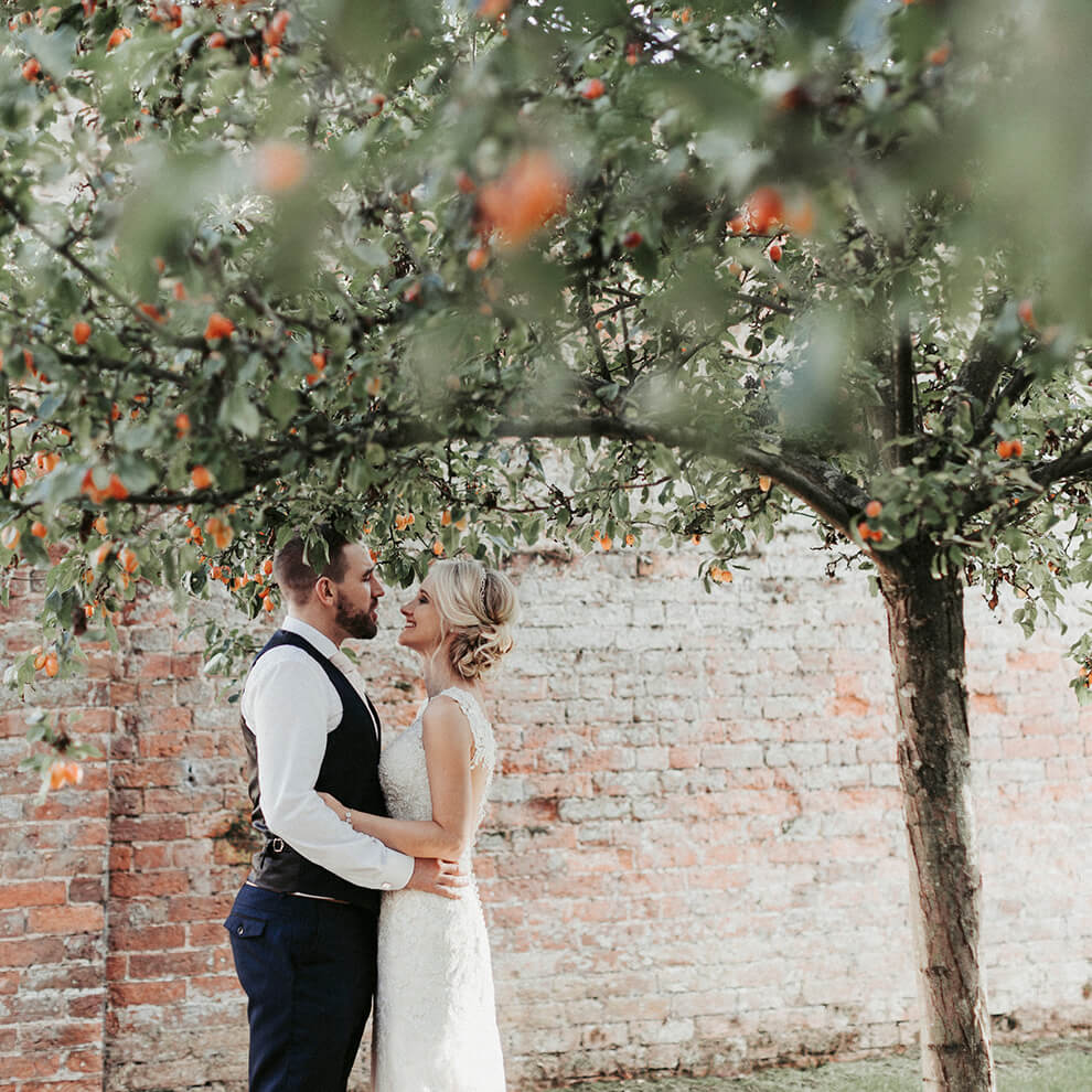 A bride and groom steal a moment on their wedding day at this beautiful Cheshire wedding venue - wedding offers