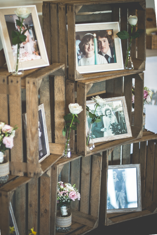 Photos of grandparents decorate wooden boxes each stacked on top of the other – rustic wedding ideas
