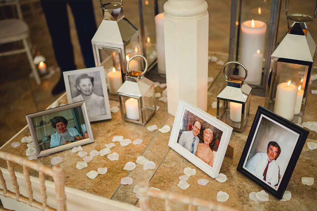 Kate and Scott decorated a table during the wedding reception with photos of grandparents – wedding ideas