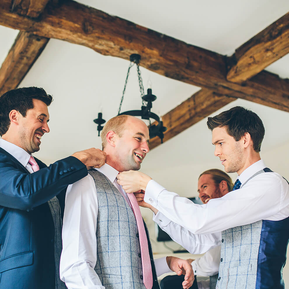 A groom gets ready in one of the ten beautifully appointed holiday cottages at Combermere Abbey