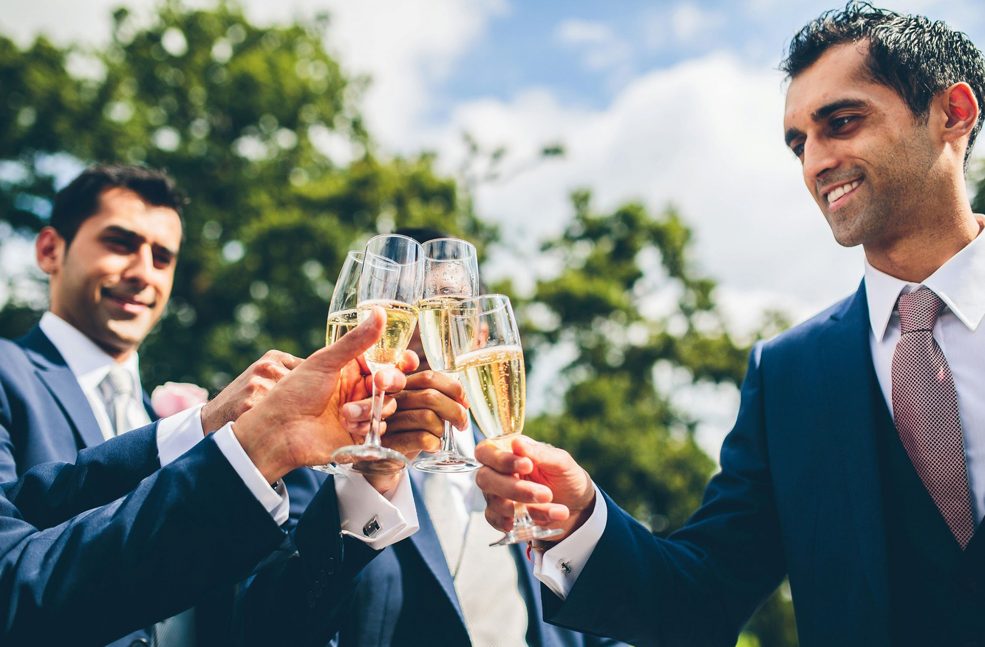 Groom and Groomsmen toast to the wedding