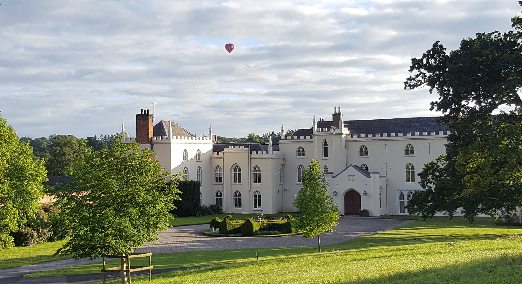 A hot air balloon over The Abbey - one of the many exciting things that take place at Combermere Abbey