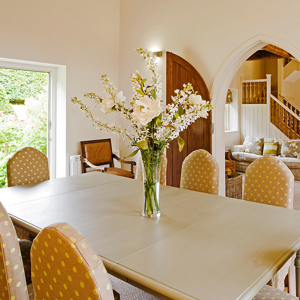 Dine in style in the truly elegant Malbanc Cottage dining room decorated in accents of yellow