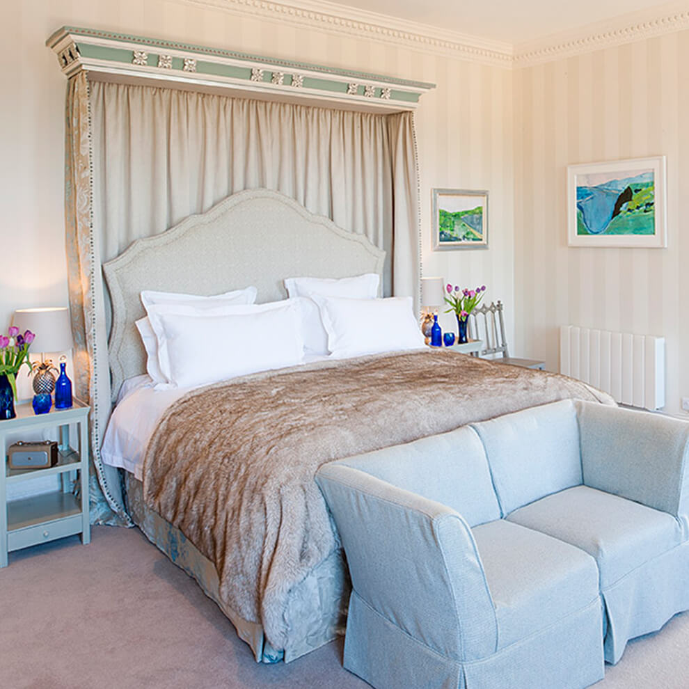 Enjoy the luxurious and elegant Salamanca bedroom in the North Wing with lake views