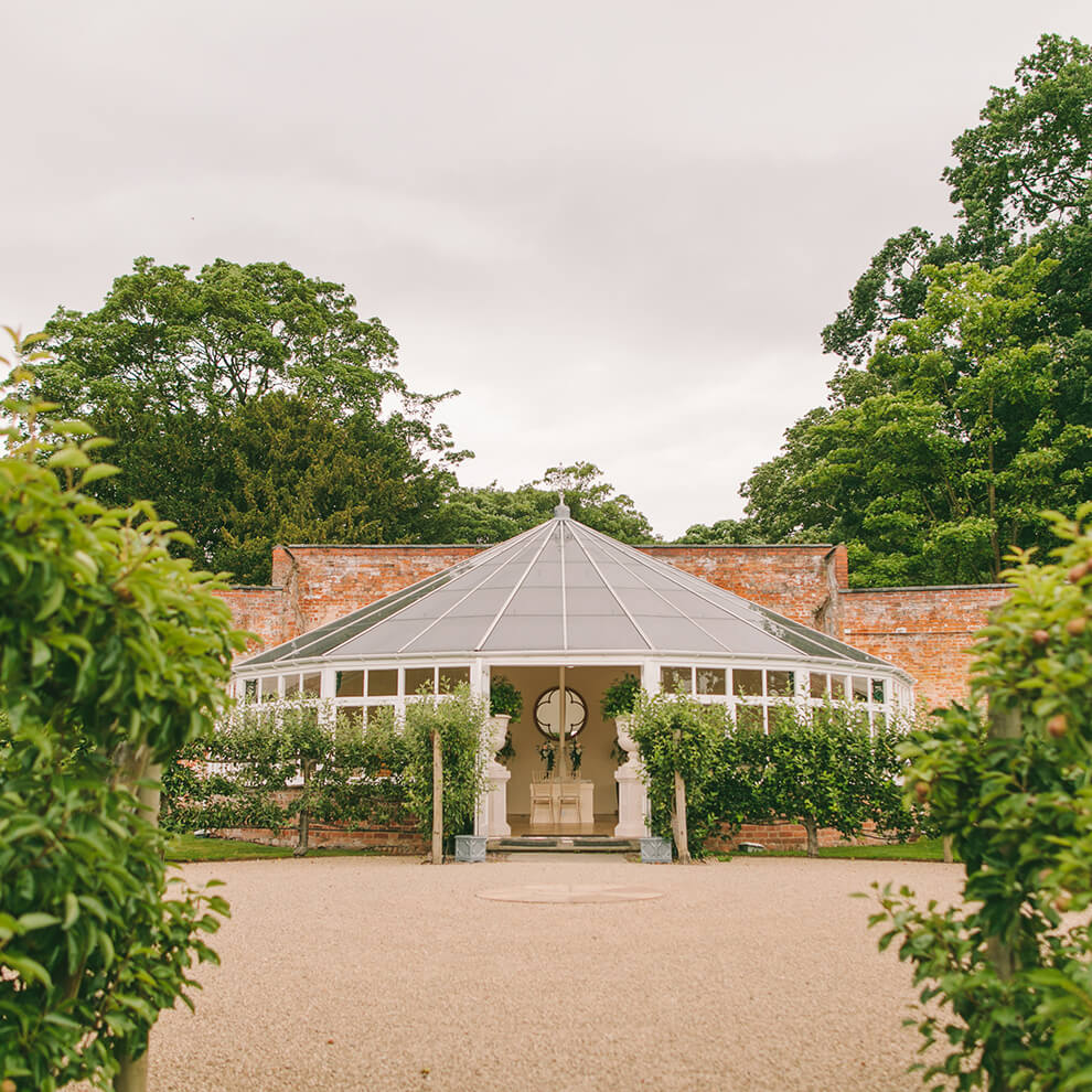 Hold your wedding ceremony in the light and airy Glasshouse surrounded by beautiful gardens