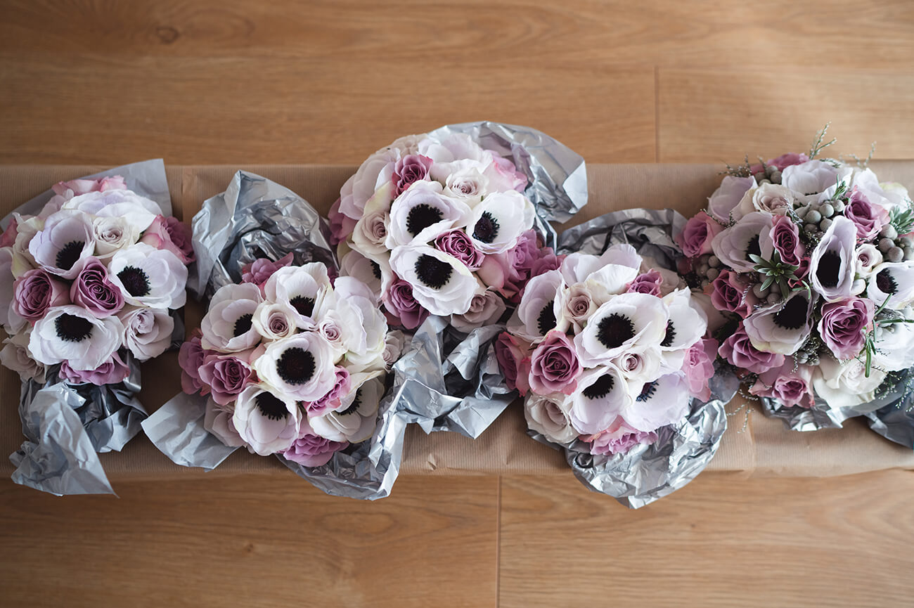The bride and bridesmaids had wedding bouquet consisting of anemones and pink roses – wedding flowers