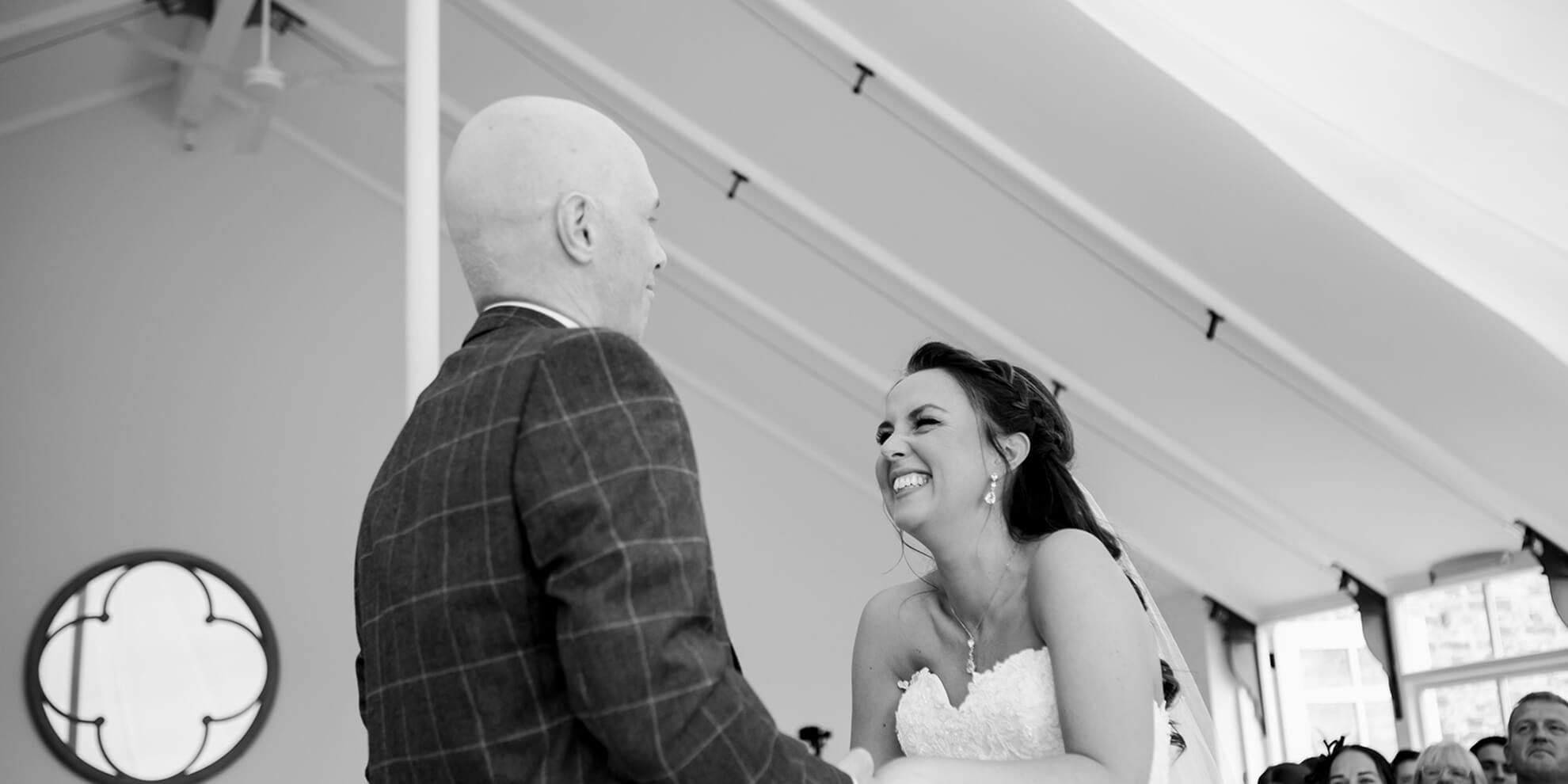 The excited couple exchange marriage vows in the Glasshouse – wedding ceremony venues Cheshire