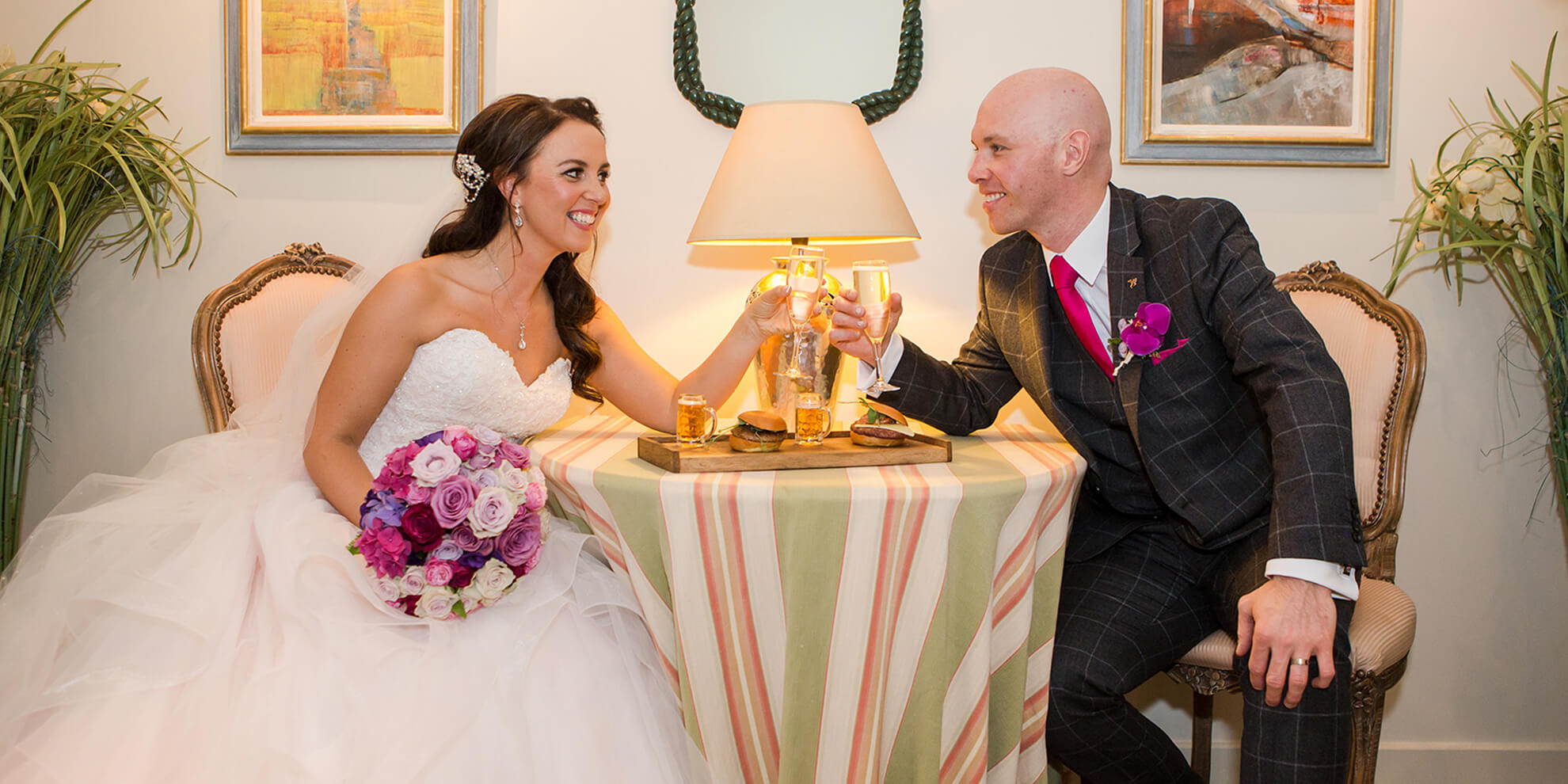 The happy newlyweds raise a glass and toast to their wedding day – autumn wedding