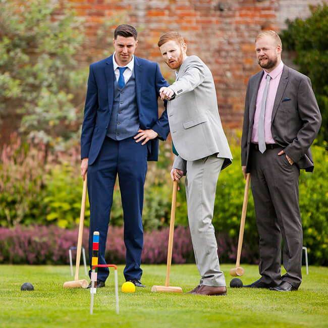 Guests enjoy the outdoor games in the Walled Garden – fun wedding ideas