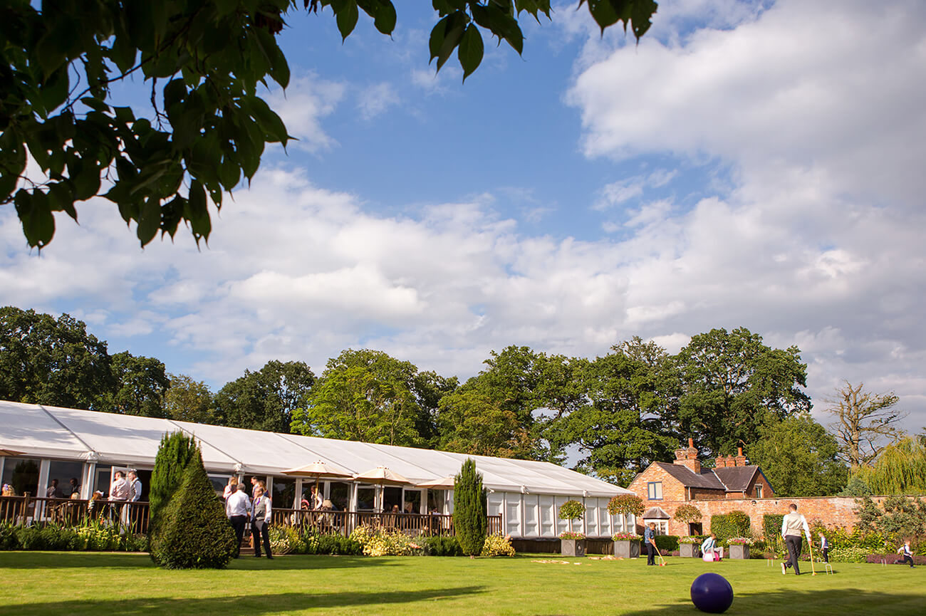 Guests play outdoor games in the Walled Garden of this stunning Cheshire wedding venue