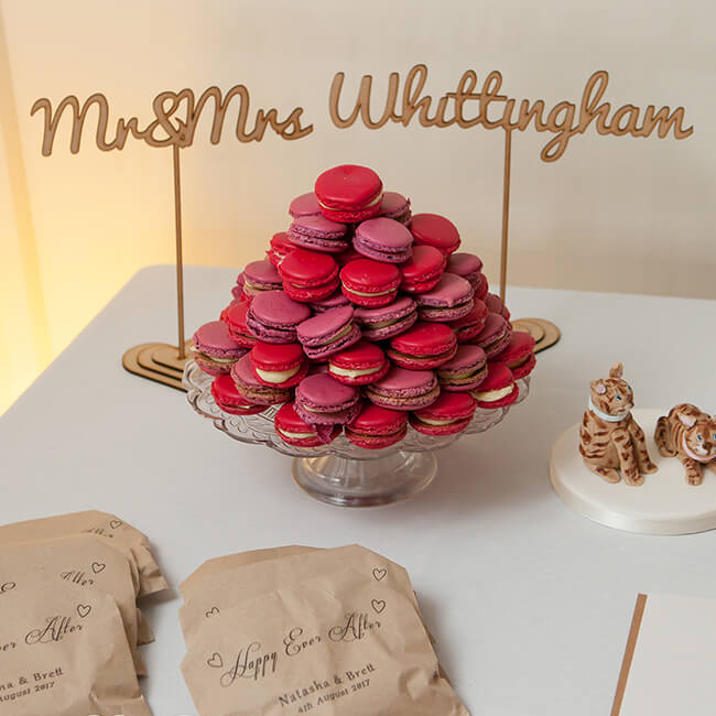 Guests are treated to pink and red macarons during the wedding reception – wedding reception ideas