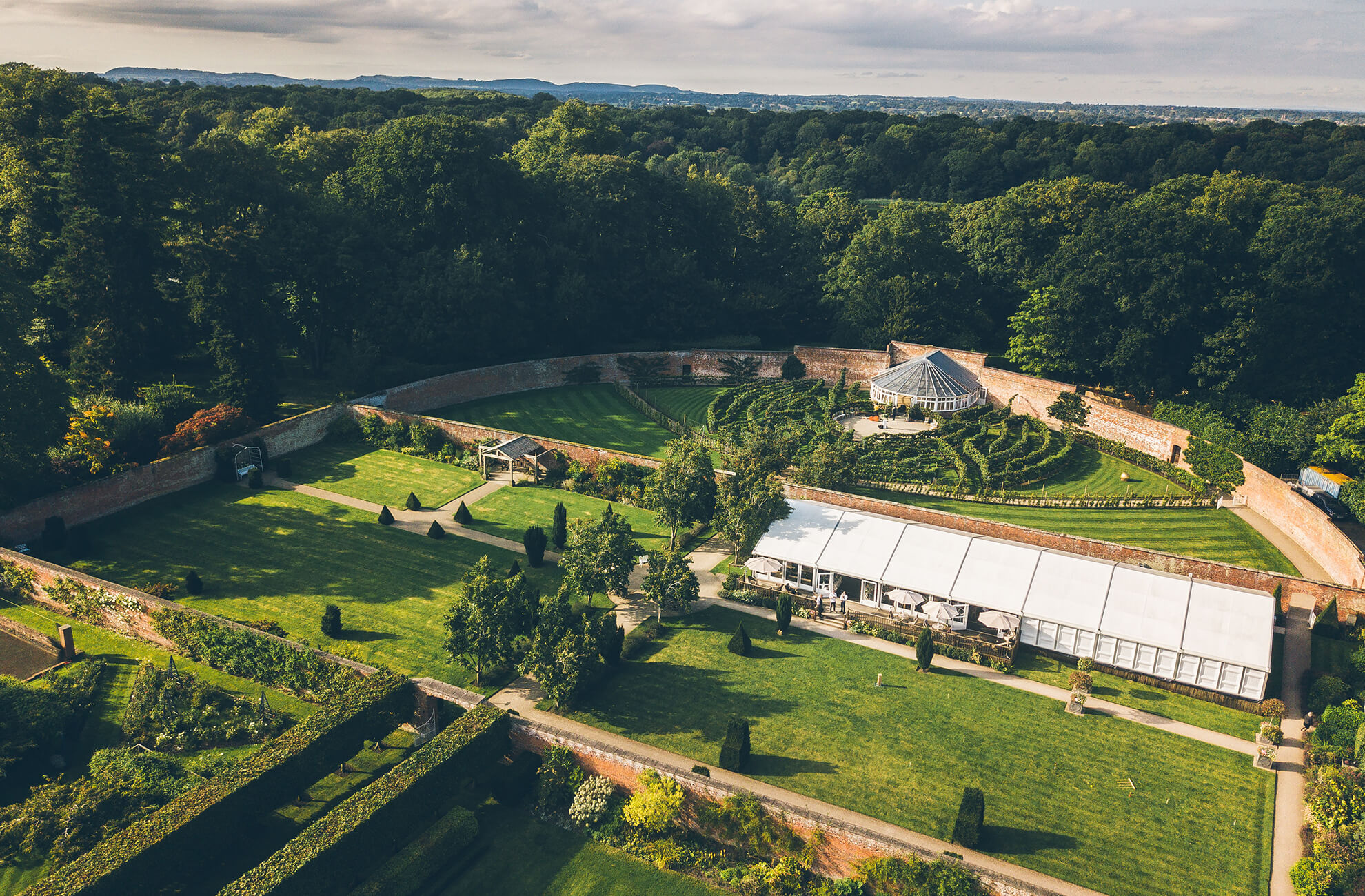 An aerial shot of the beautiful glasshouse and gardens at Combermere Abbey wedding venue in Cheshire
