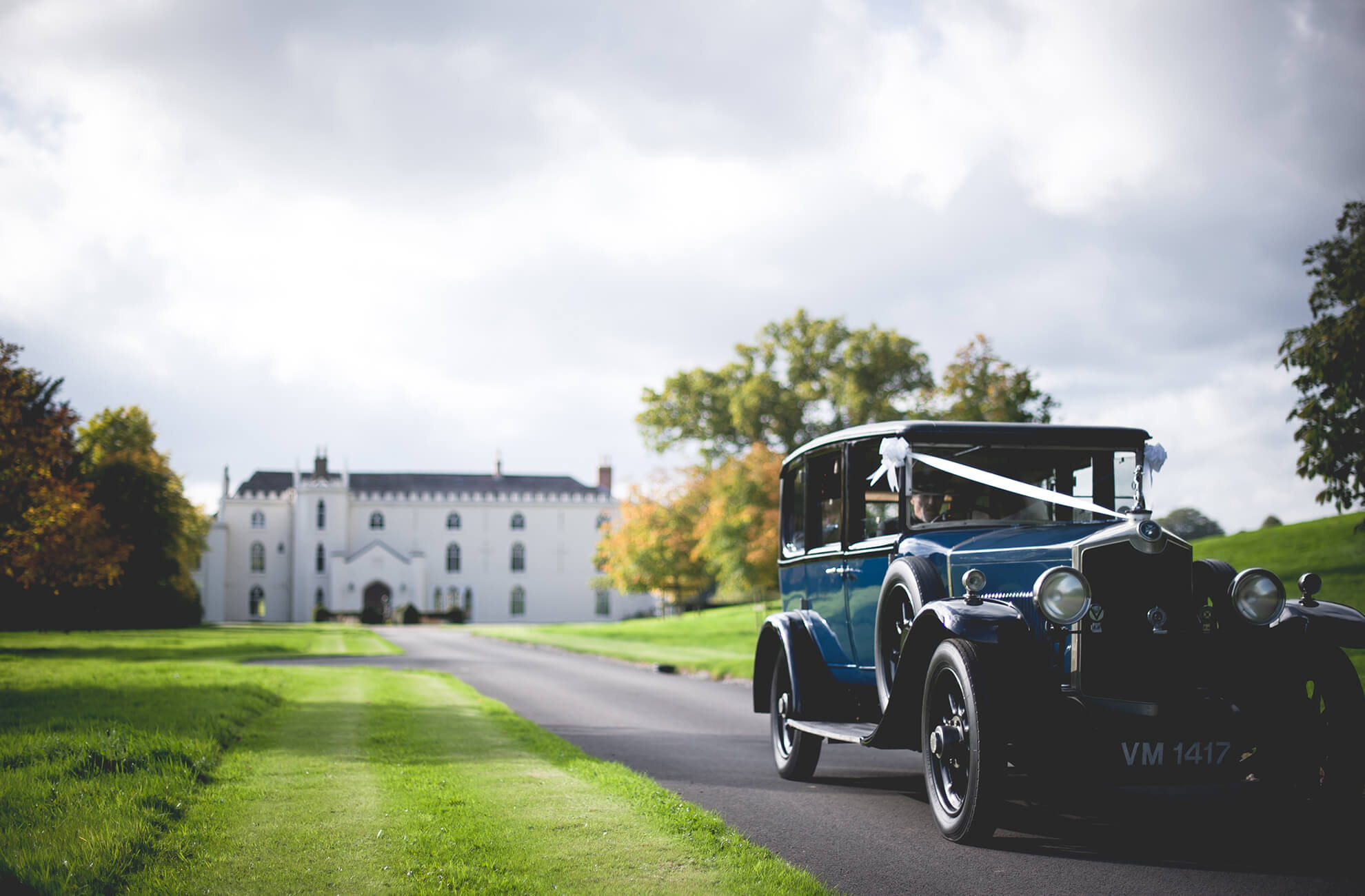 Begin your wedding day with a vintage car-ride up the mile-long driveway at Combermere Abbey in Cheshire