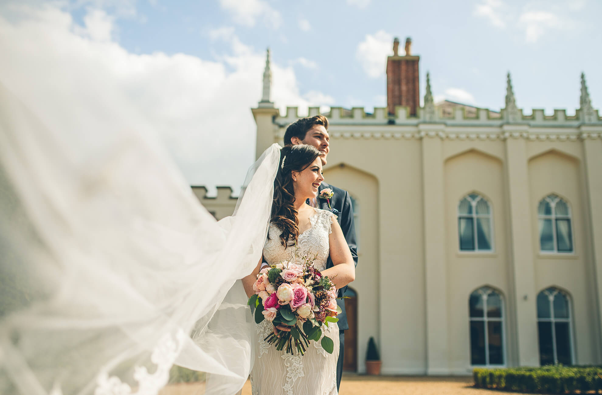The new husband and wife take a moment in front of the Edwardian House at Combermere Abbey in Cheshire