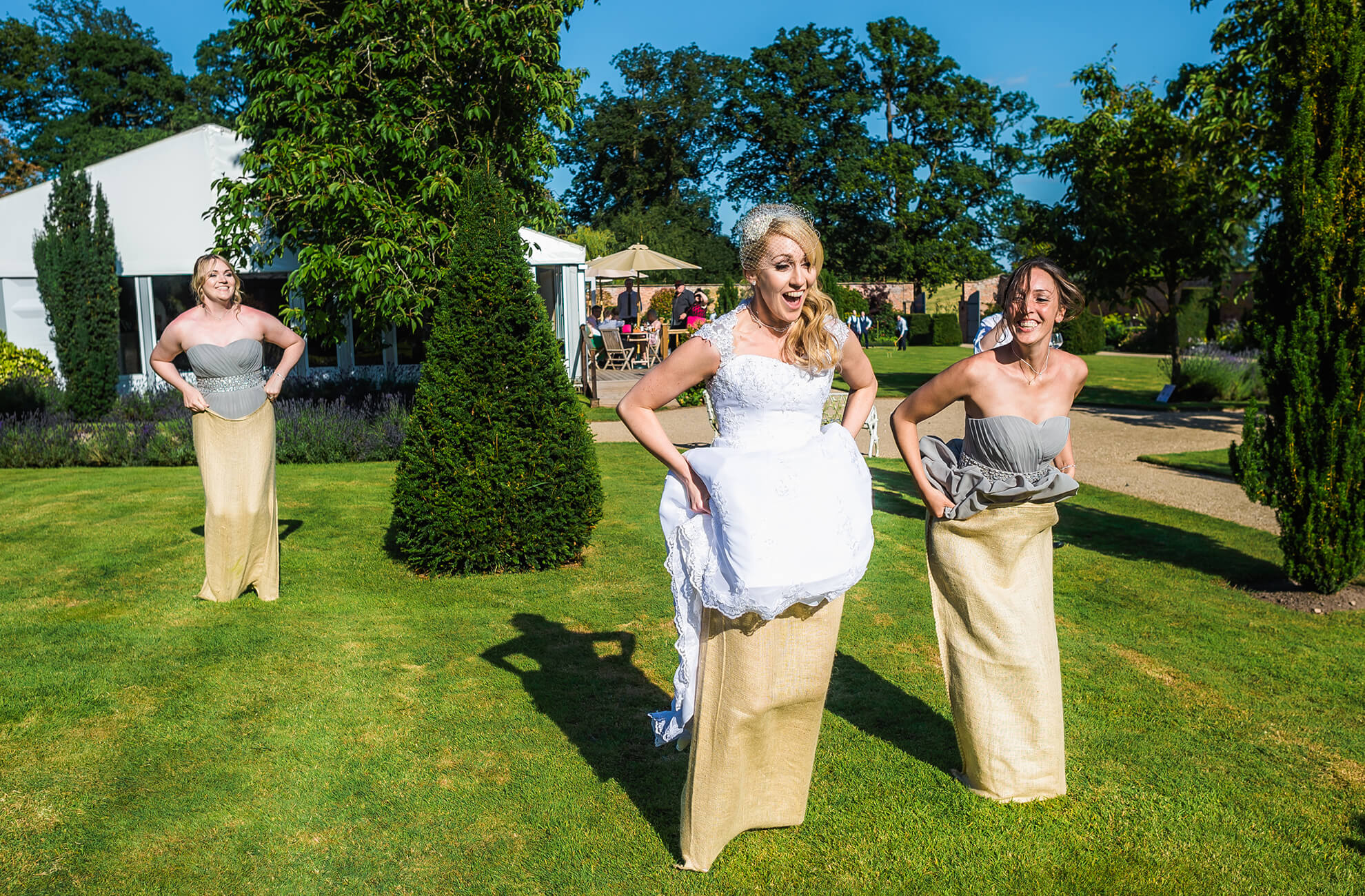 At the Cheshire wedding venue the bride and her bridesmaids take part in a competitive sac race during the wedding reception