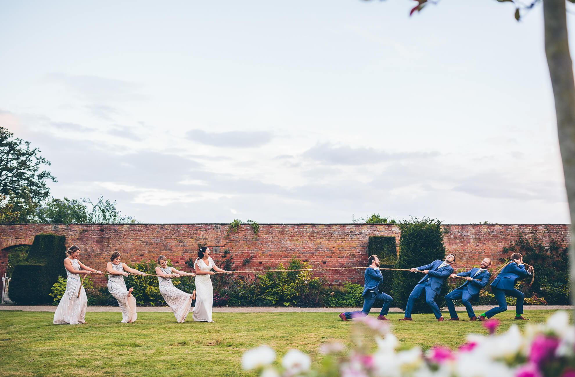 The gardens at the Cheshire wedding venue are a great space for bridesmaids and ushers to enjoy a wedding game of tug of war