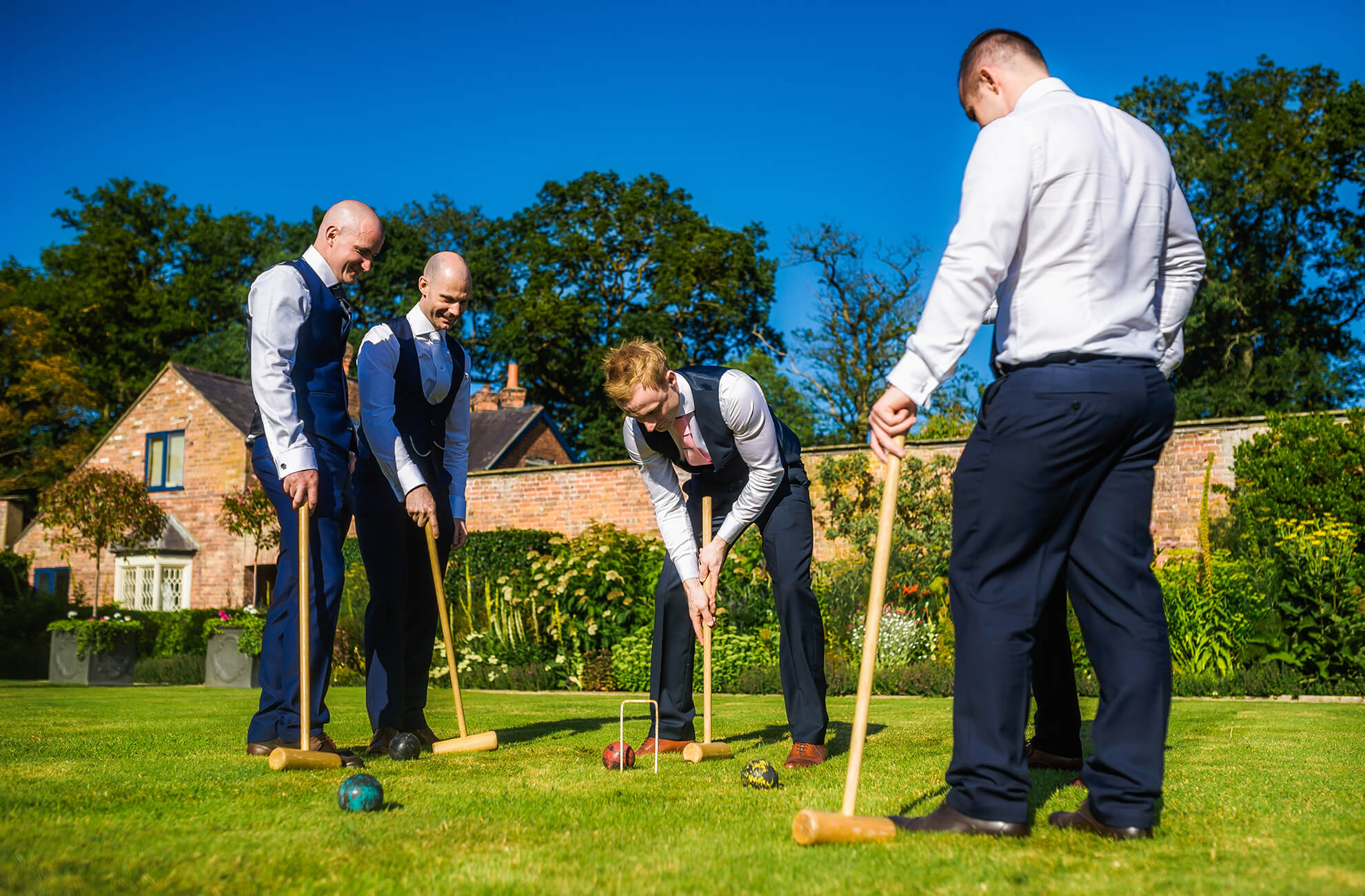 Croquet is a great wedding game for guests to enjoy in the gardens at Combermere Abbey in Cheshire