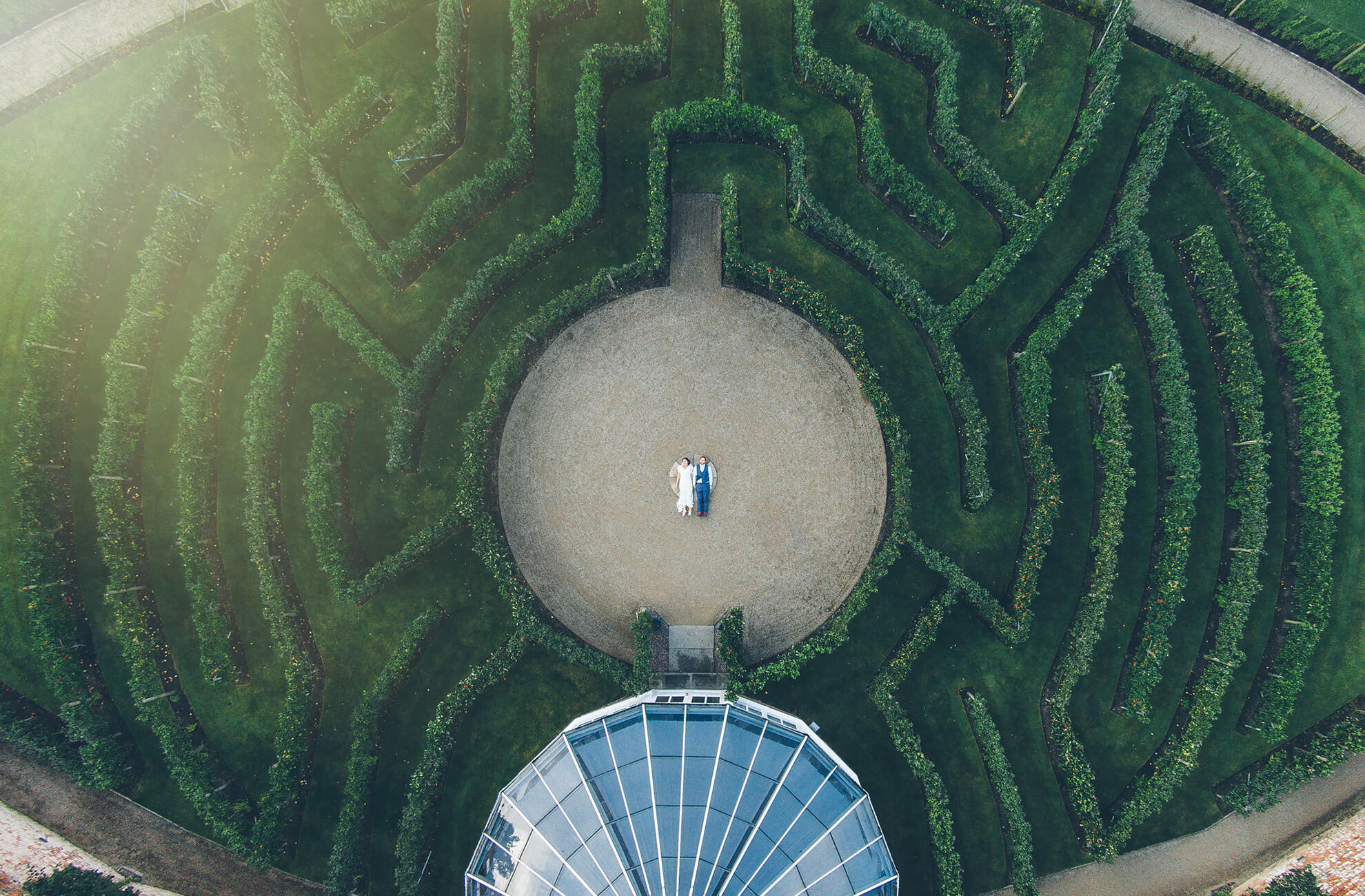 An aerial shot of a bride and groom in the middle of the fruit tree maze at Combermere Abbey in Cheshire