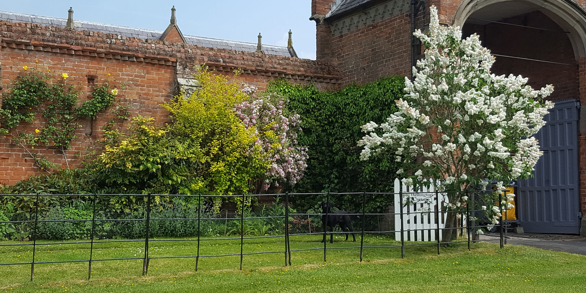 The self-catering cottages at Combermere Abbey are surrounded by greenery and blossoming flowers