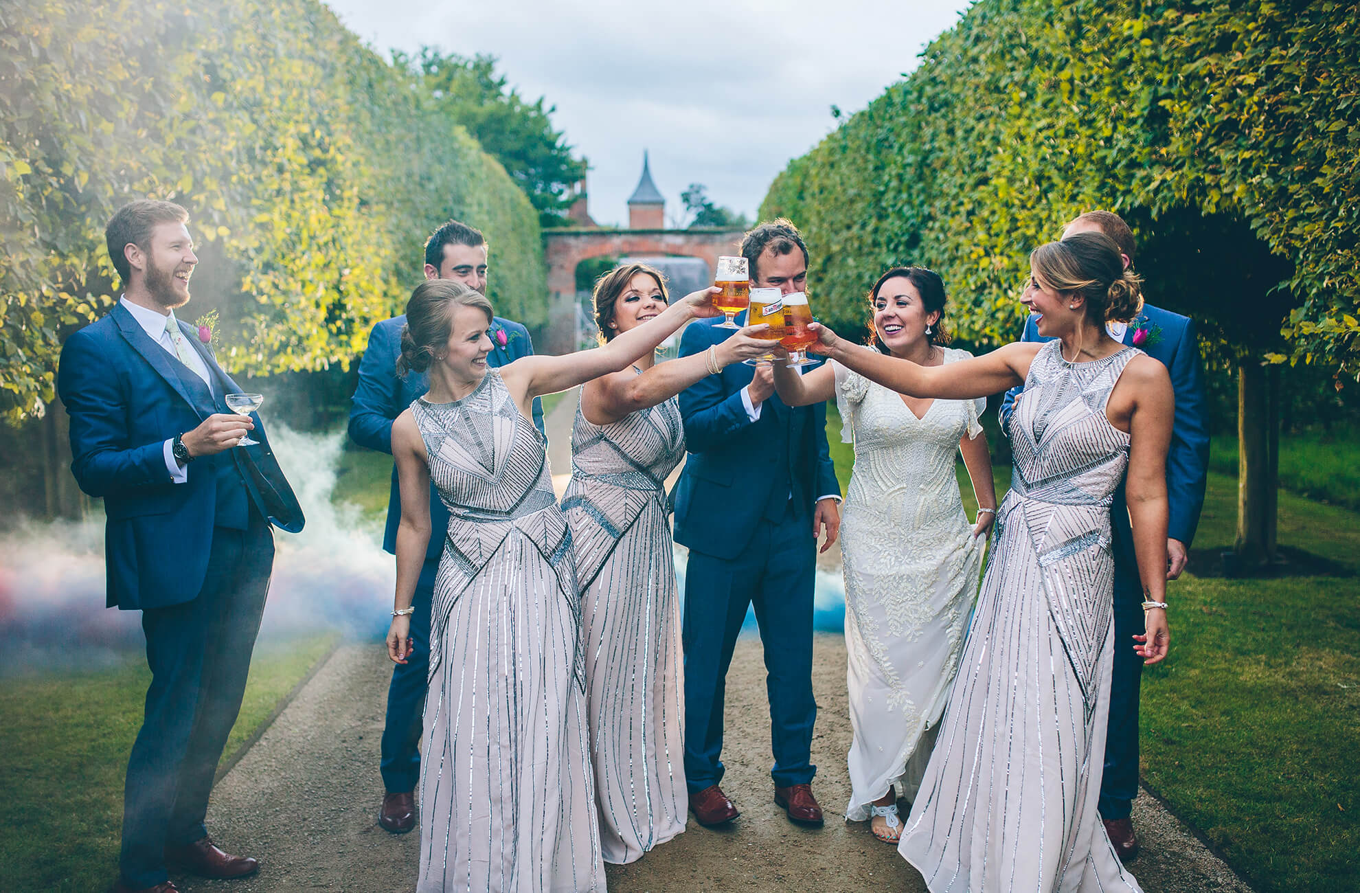 The bridal party join the bride and groom wearing sequin bridesmaid dresses for a vintage look