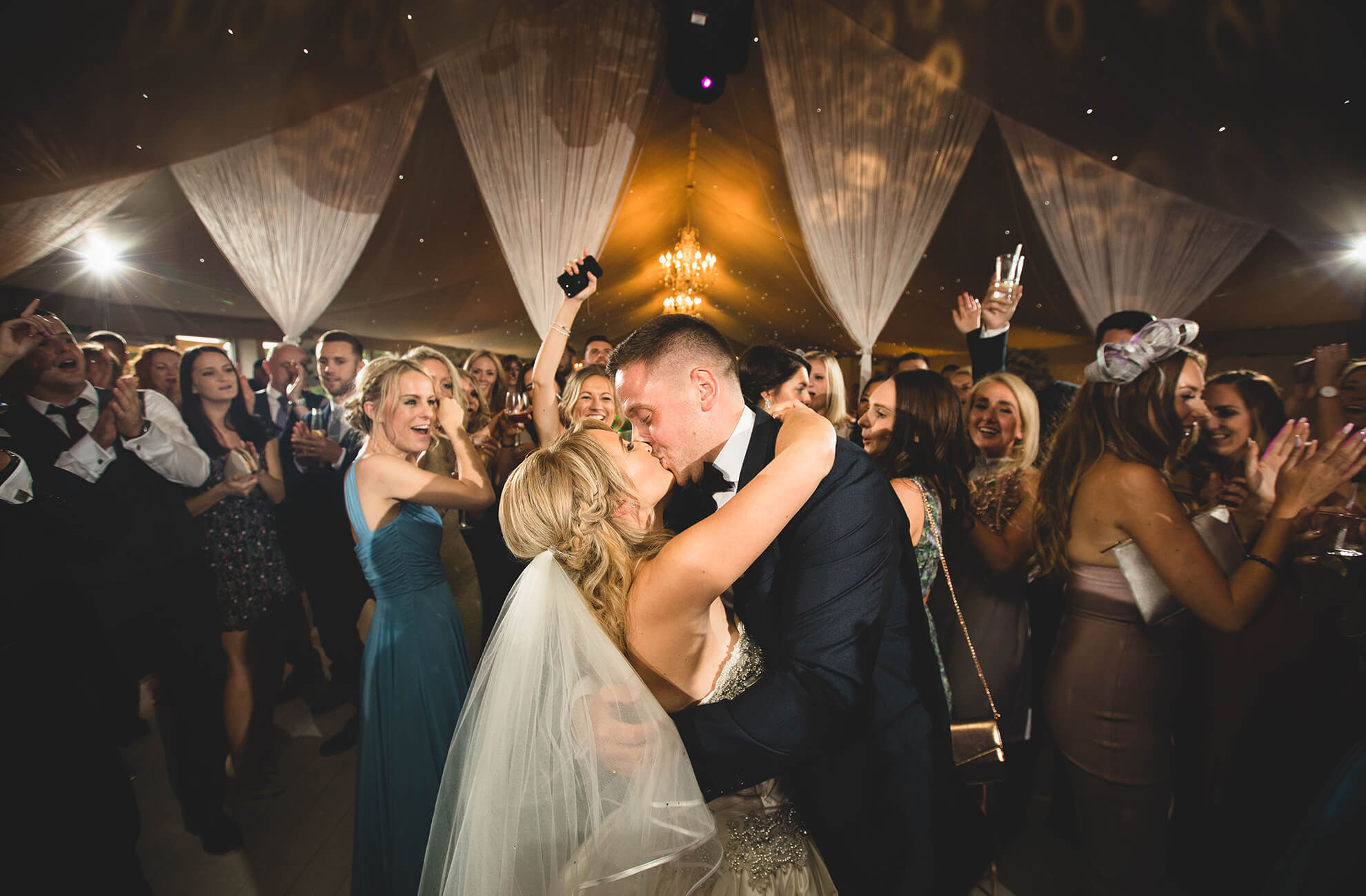 A husband and wife enjoy their first dance in the Pavillion at Combermere Abbey in Cheshire