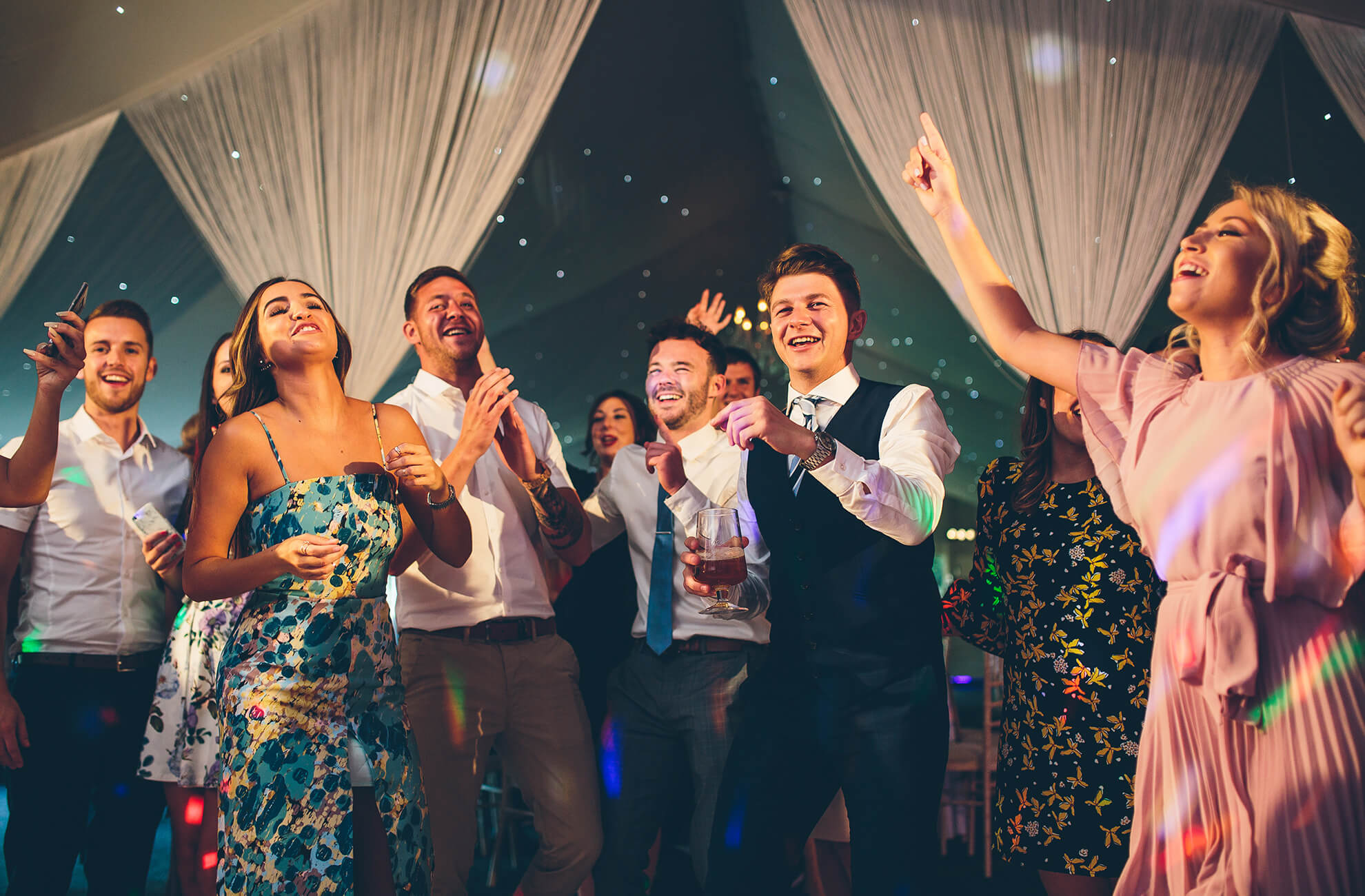 Wedding guests dance the night away during an evening wedding reception at Combermere Abbey