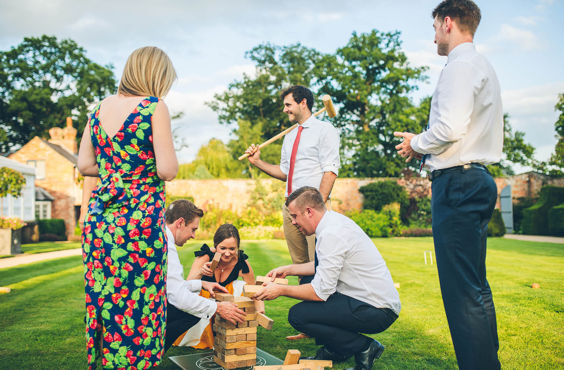 Wedding guests enjoy lawn games in the gardens at Combermere wedding venue in Cheshire