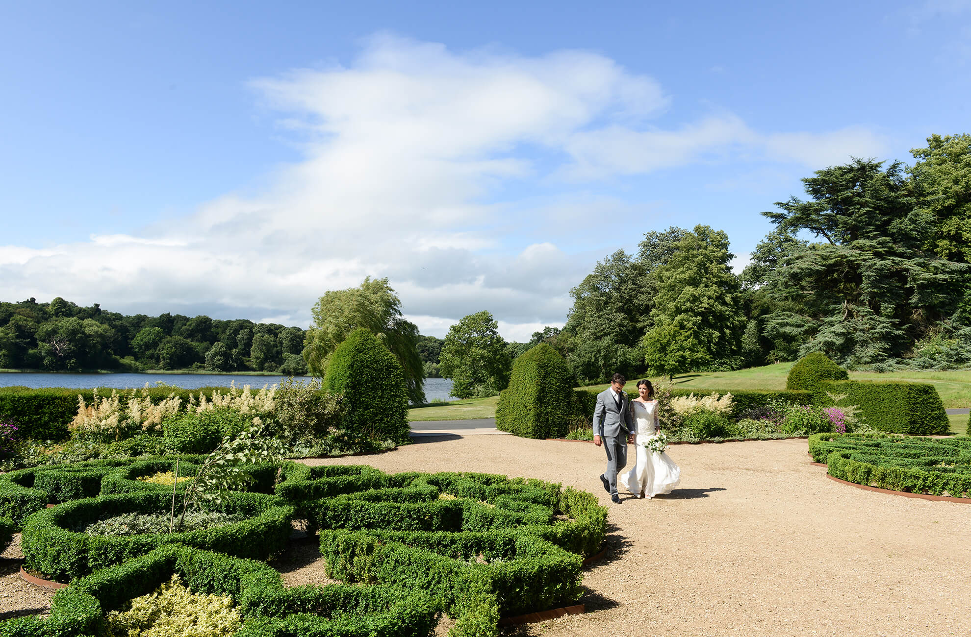 The bride and groom take a walk by the lake at this country wedding venue in Cheshire
