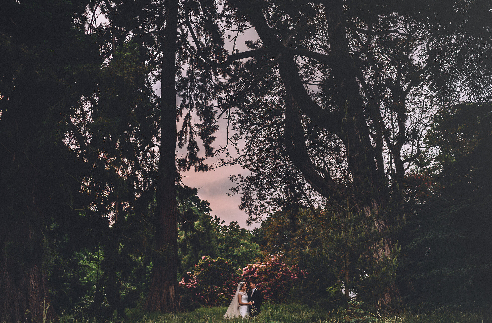 The bride and groom have a private moment on their wedding day in the woodland at this Cheshire wedding venue
