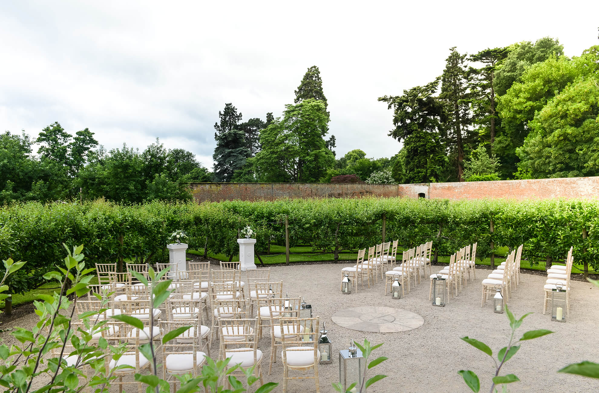 The middle of the Fruit Maze at Combermere Abbey is set up for a summer outdoor wedding ceremony