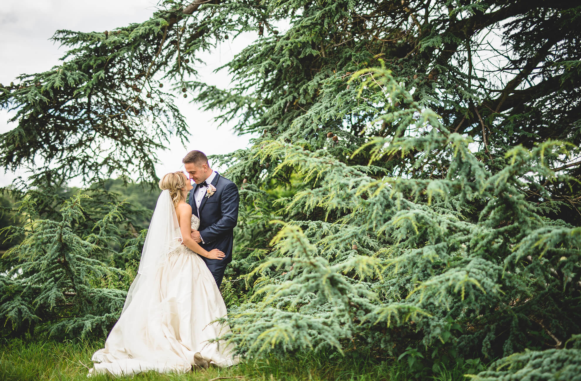 The bride and groom share a special moment in the woodland at Combermere Abbey on their wedding day