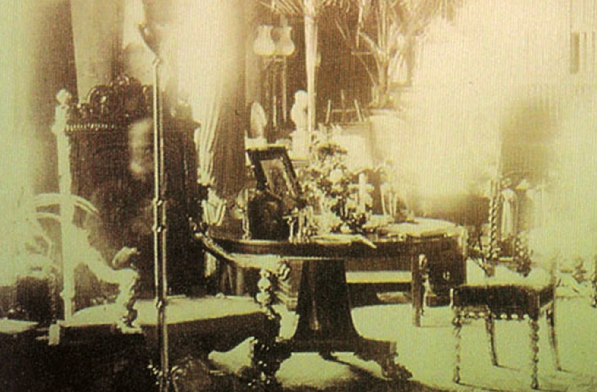 An old photograph of the ghost of Lord Combermere of Combermere Abbey as he sits in the library