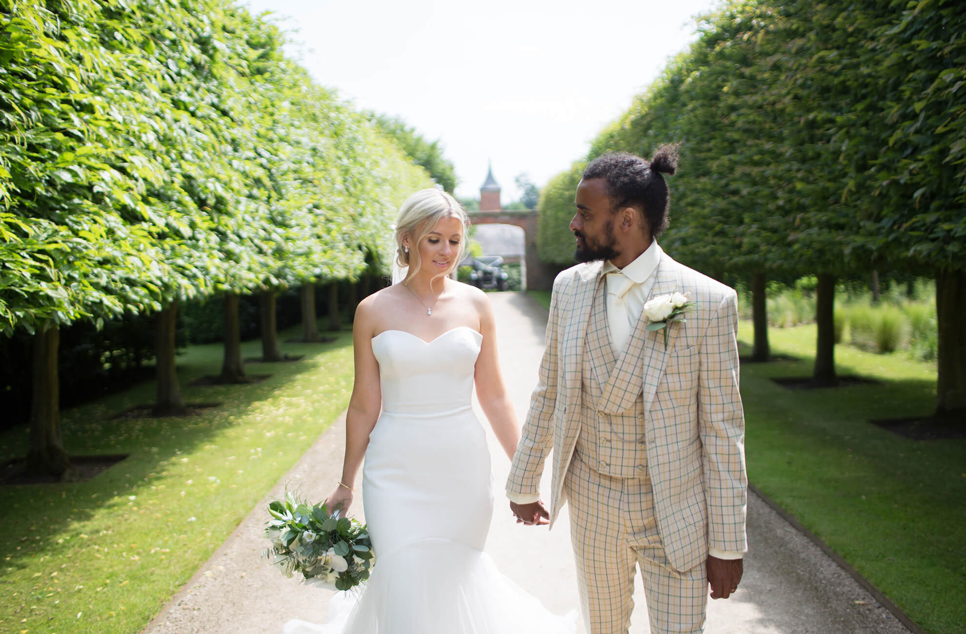 Newlyweds explore the Victorian gardens at this beautiful country wedding venue in Cheshire