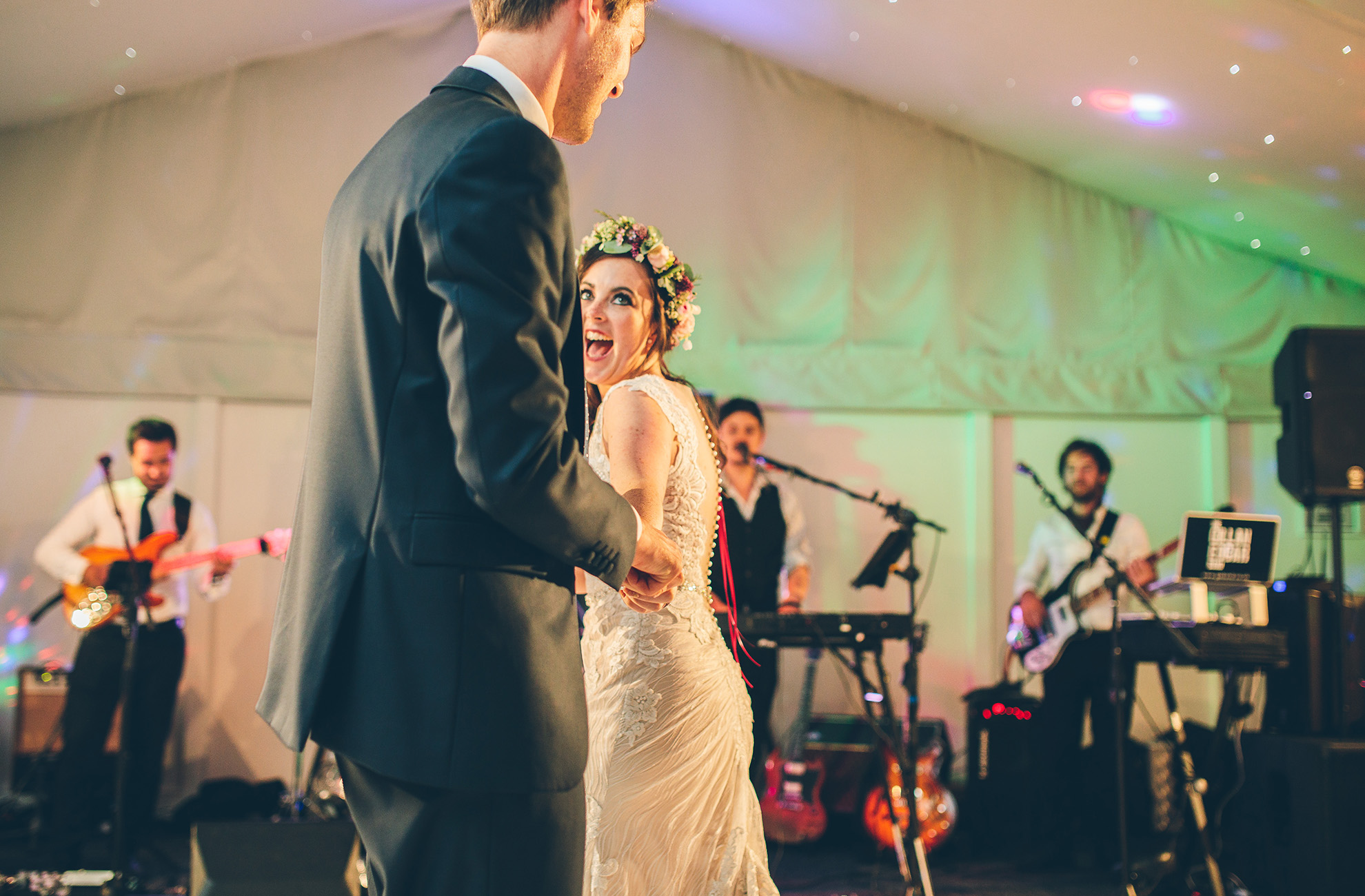 A bride and groom enjoy their first dance in front of guests at Combermere Abbey wedding venue in Cheshire