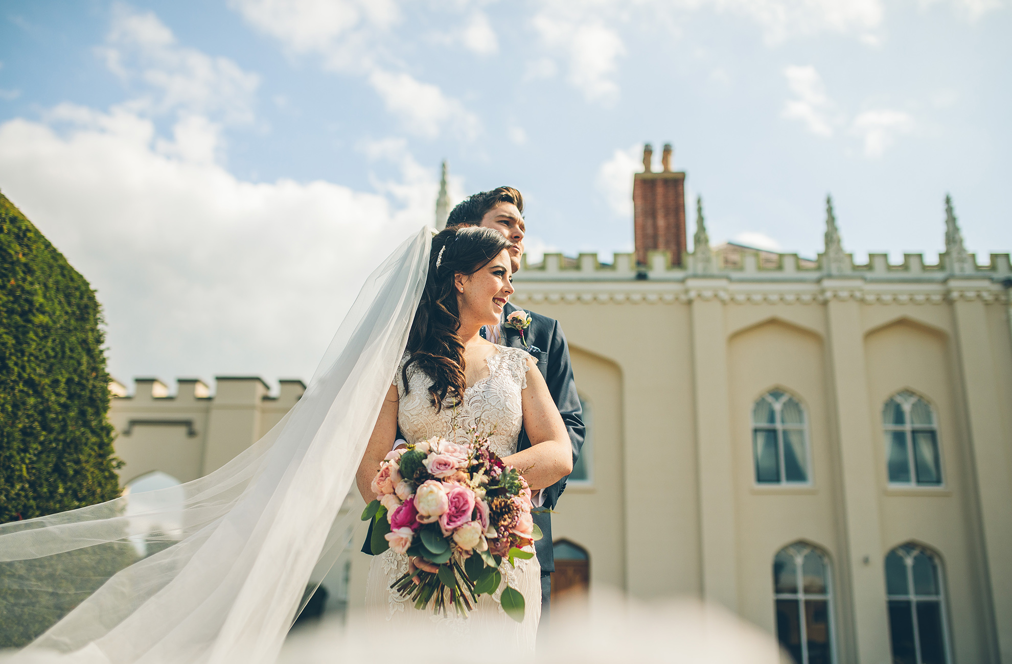 A bride and groom take time away from guests on their wedding day at Combermere Abbey