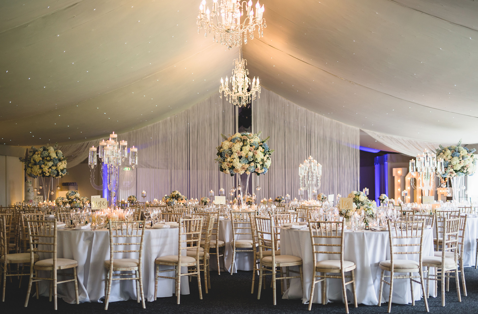 The Pavillion at Combermere Abbey wedding venue in Cheshire is set up for an elegant wedding reception