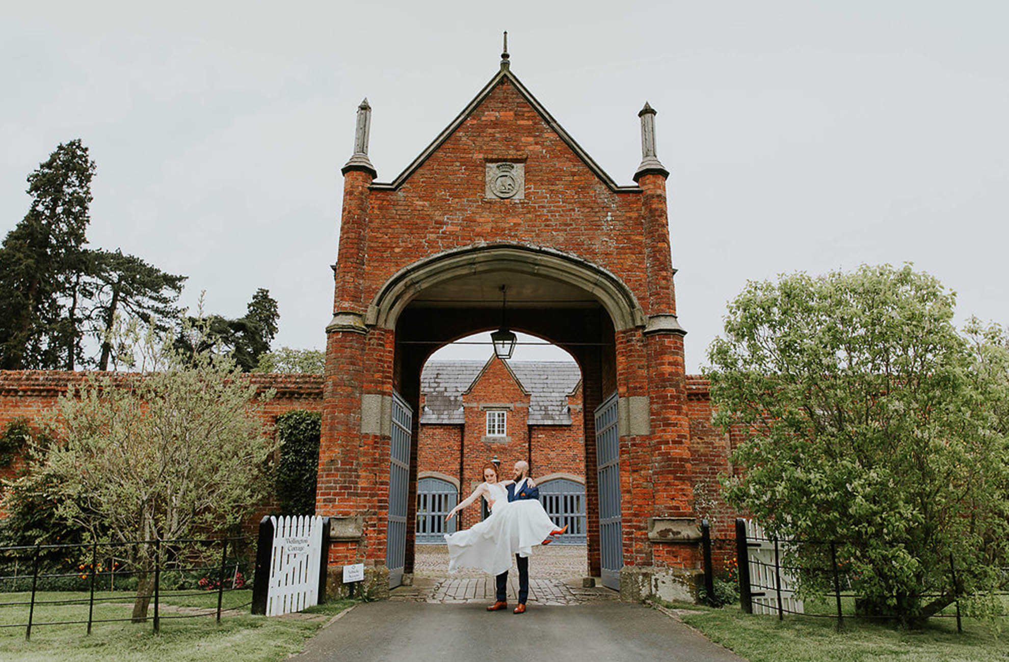 A bride and groom enjoy exploring the grounds at Combermere Abbey on their wedding day