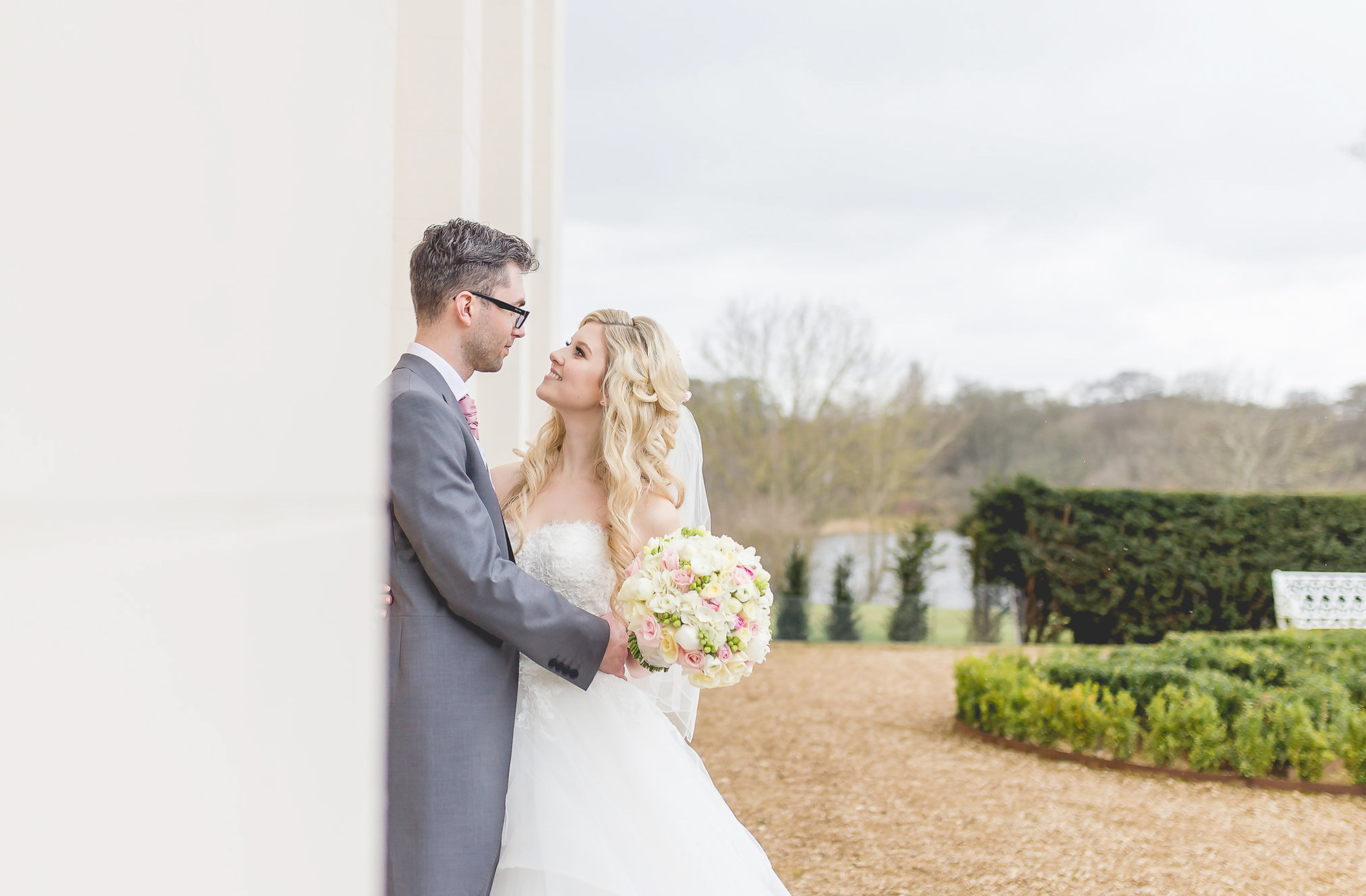Newlyweds head to the North Wing at Combermere Abbey to capture some beautiful wedding photographs