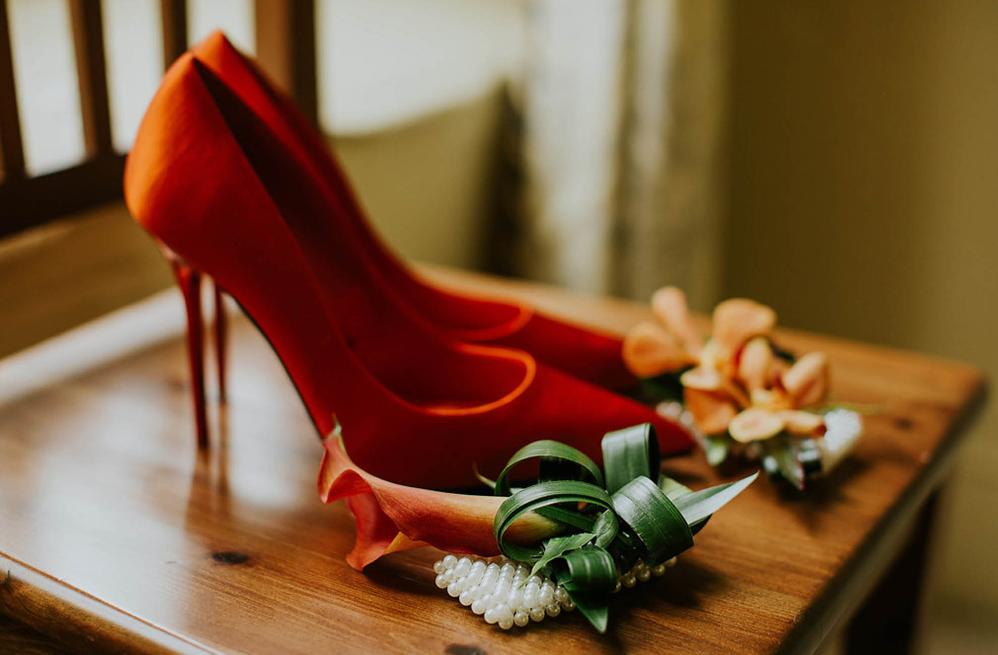 The bride wore orange wedding shoes to match the theme of her day at Combermere Abbey