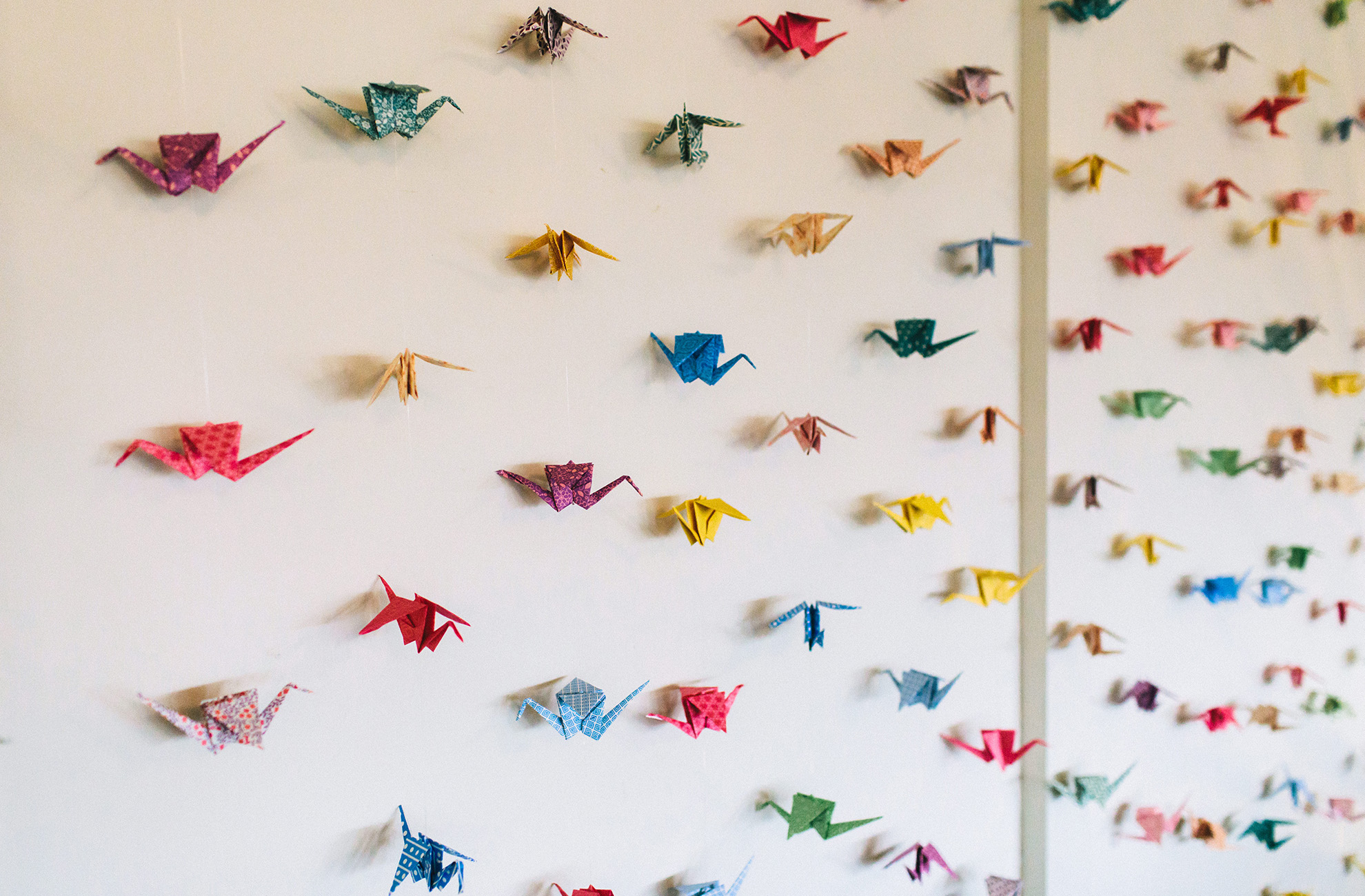 Create origami swans for an alternative backdrop in the Pavillion at Combermere Abbey