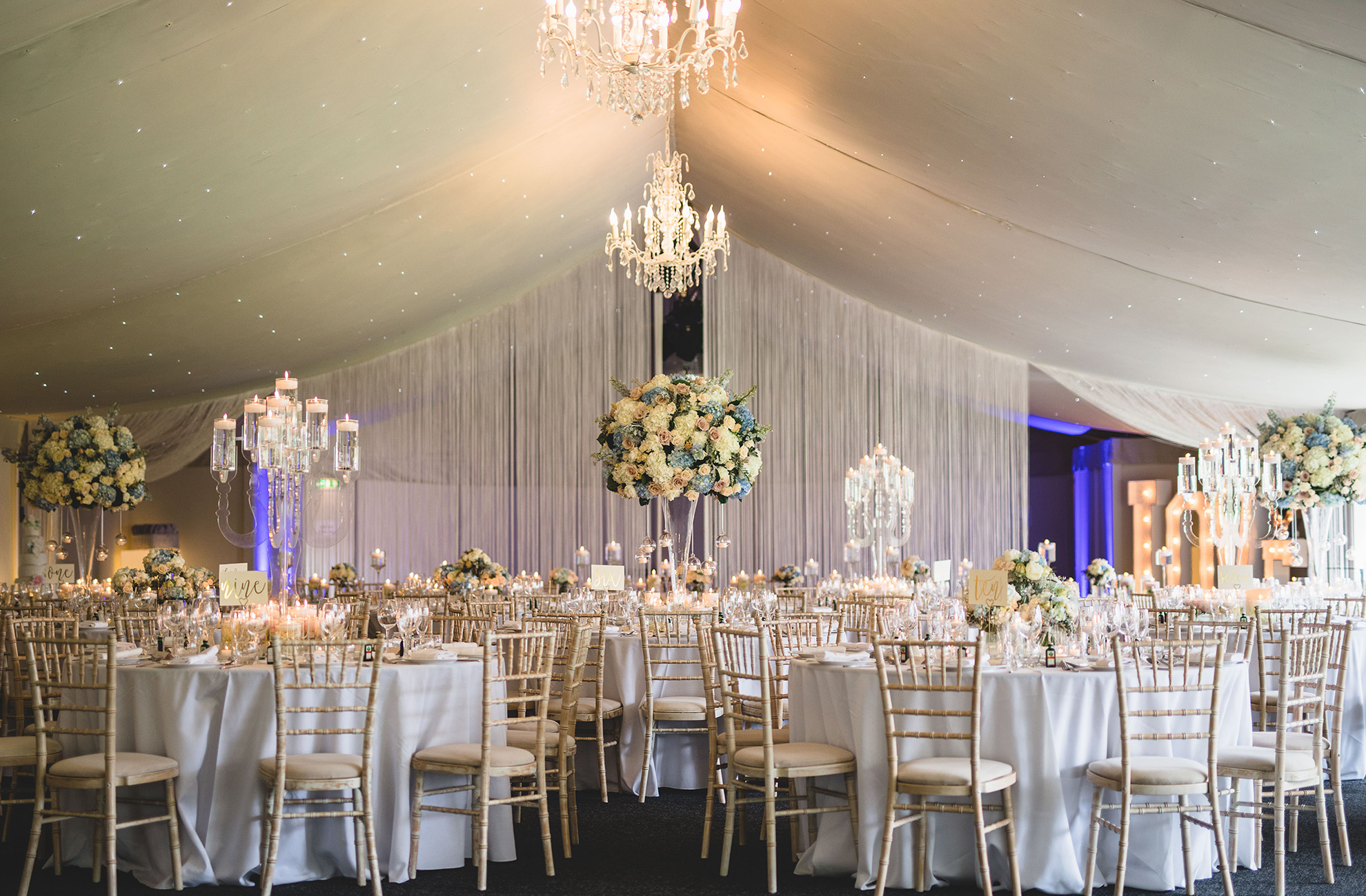 The Pavillion at Combermere Abbey is decorated with pastel shades for a spring wedding reception