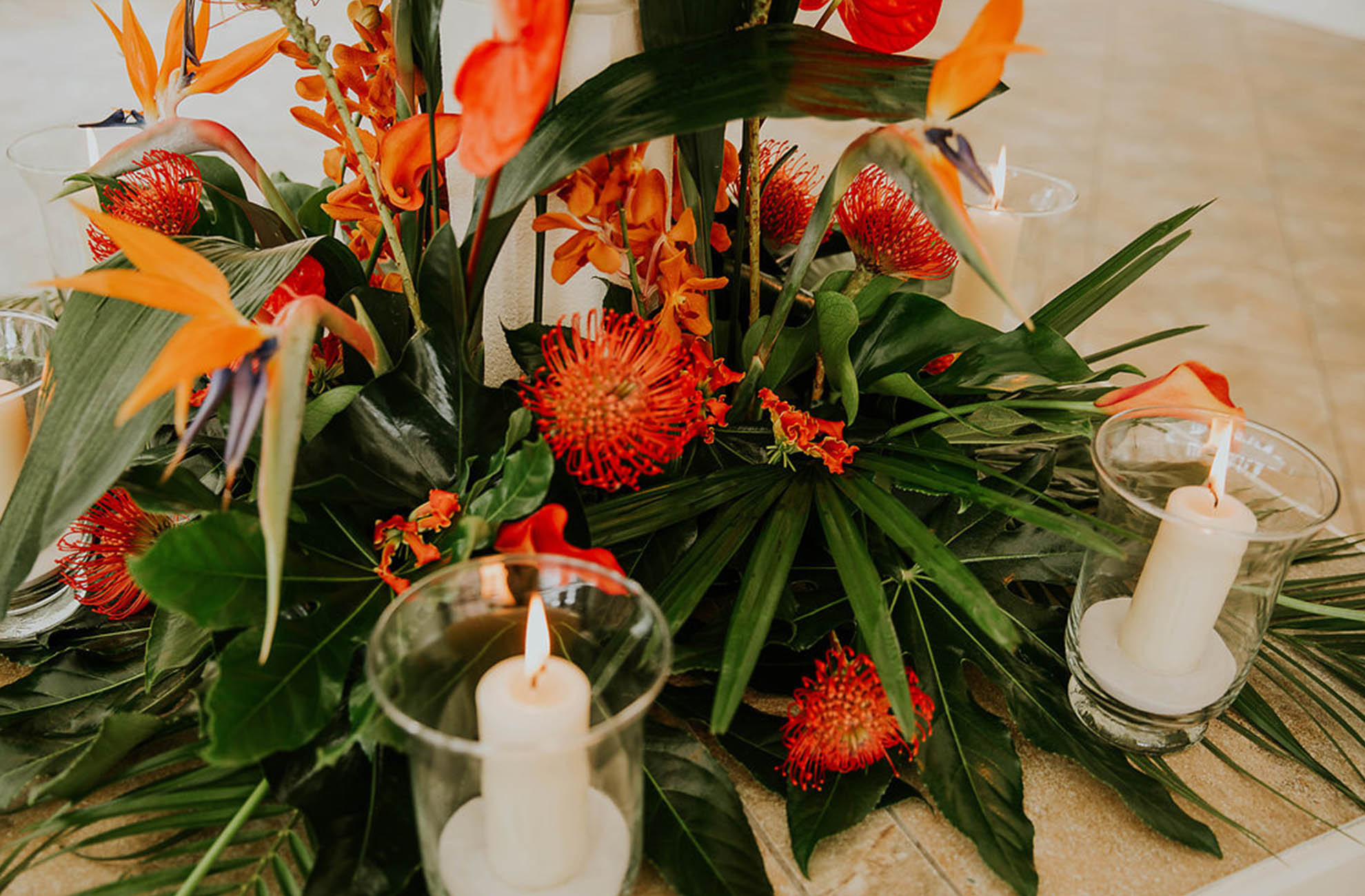 The couple chose exotic orange wedding flowers for their big day at Combermere Abbey