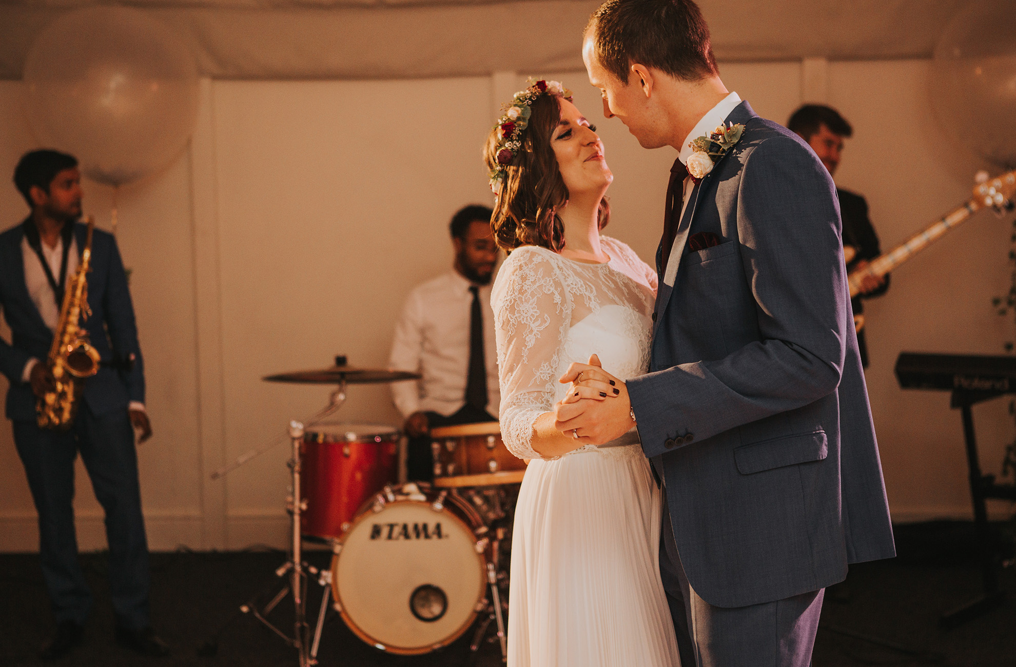 A band play the music for a couples first dance as husband and wife during their reception at Combermere Abbey