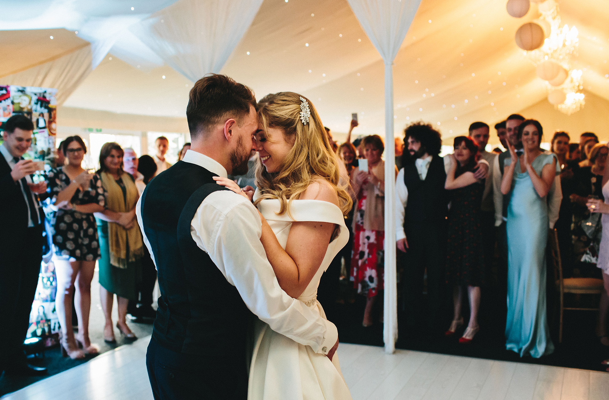 The bride and groom perform their first dance as husband and wife in front of guests at Combermere Abbey