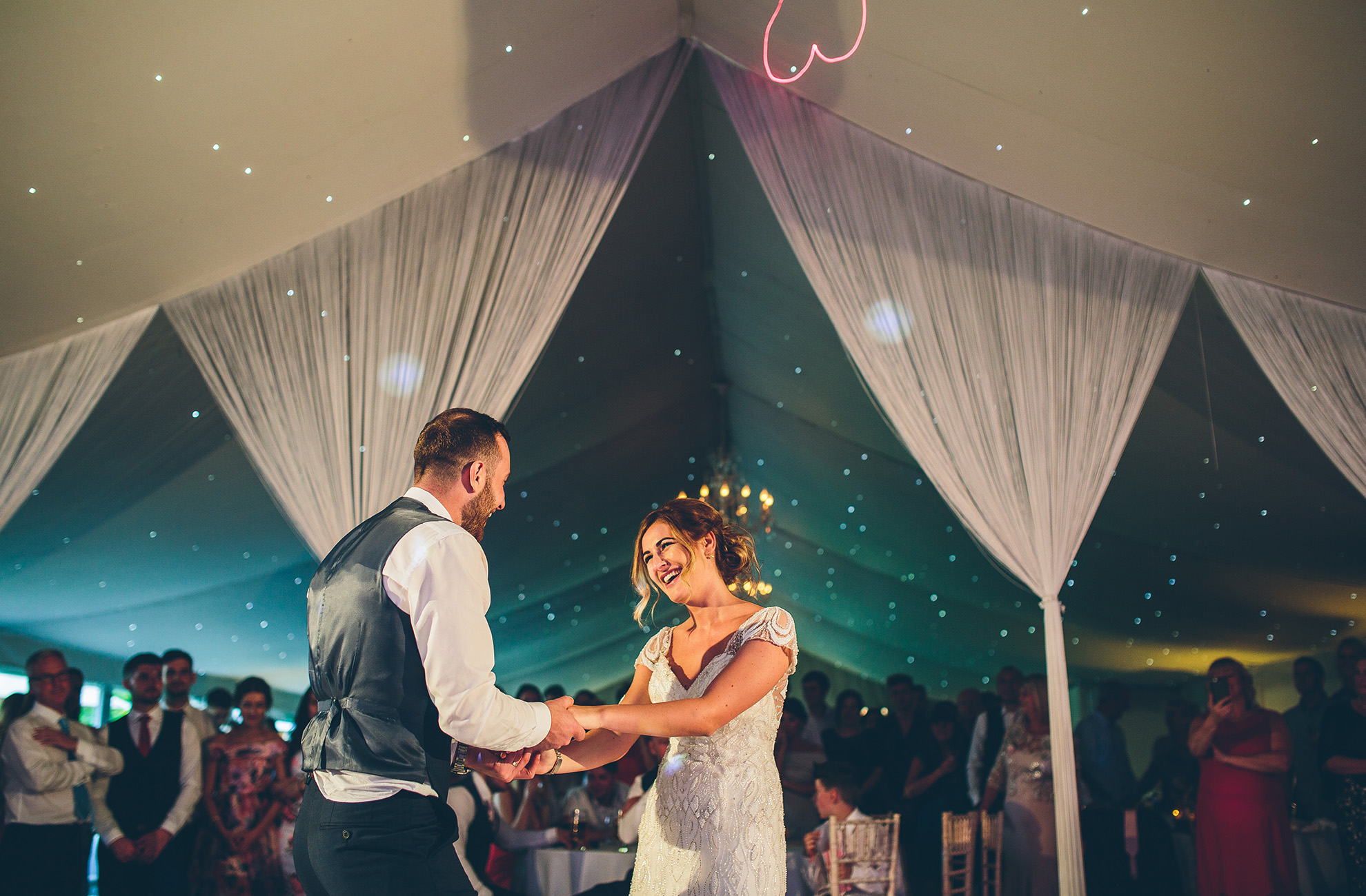A bride and groom have fun during their first dance at Combermere Abbey wedding venue in Cheshire